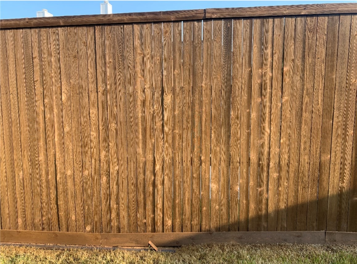 stains cover the knots in the fence