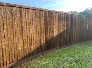 will stain cover knots in the fence