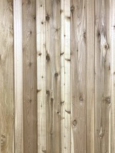 Stain cover knots in the fence